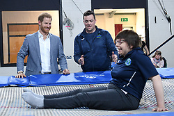 The Duke of Sussex meets a participant of the Rebound Therapy session as he visits the OXSRAD Disability Sports and Leisure Centre, in Oxford.