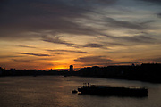Golden sky at sunset looking over the River Thames at Wapping in East London, England, United Kingdom. (photo by Mike Kemp/In Pictures via Getty Images)