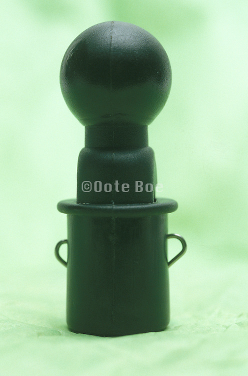 Flute from a water kettle on a green background