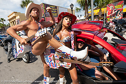 The Naked Cowboy and Naked Cowgirl both came down from New York to strum Main Street during Daytona Beach Bike Week, FL. USA. Friday, March 15, 2019. Photography ©2019 Michael Lichter.