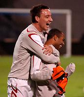 Photo: Richard Lane<br />England Training Session. 10/10/2006. <br />England captain, John Terry (lt) jumps on Ashley Cole.