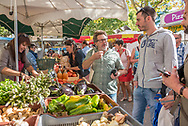 Open air food market in Saint-Quentin-la-Poterie near Uzes in France, on tour with Cook'n With Class cooking school in Uzes.