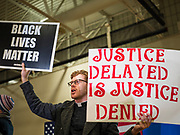 01 MARCH 2020 - ST. LOUIS PARK, MINNESOTA: A Christian minister stands in support of Black Lives Matter protesters who disrupted a campaign rally for Sen. Amy Klobuchar. Dozens of Black Lives Matter (BLM) protesters disrupted Sen. Amy Klobuchar's last presidential election rally in Minnesota before Super Tuesday. Almost 500 Klobuchar supporters came to hear Sen. Klobuchar, when the BLM protesters marched into the hall and took control of the stage. Klobuchar cancelled the event about an hour after the BLM protesters entered the hall. The protesters targeted Klobuchar because while she was the Hennepin County Attorney, she oversaw the conviction of Myon Burrell, a black teenager accused and convicted of murder. Evidence has come to light since his conviction that suggests he was wrongly convicted. His conviction has become a flashpoint in Minnesota politics.         PHOTO BY JACK KURTZ