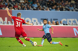 September 26, 2018 - Bronx, New York, US - Chicago Fire midfielder BASTIAN SCHWEINSTEIGER (31) fights to clear the ball away from New York City FC midfielder MAXIMILIANO MORALEZ (10) during a regular season match at Yankee Stadium in Bronx, New York.  New York City FC defeats Chicago Fire 2 to 0 (Credit Image: © Mark Smith/ZUMA Wire)