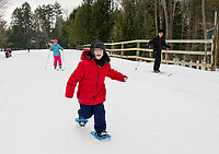 """When I asked William about his first snowshoeing experience his response was """"all it takes is determination"""".  Mrs. Besegai and Mrs. Morin's 5th grade class from Elm Street School spend Thursday morning at Bolduc Park to try snowshoeing, cross country skiing and skating as part of learning about winter Olympics sports.  (Karen Bobotas/for the Laconia Daily Sun)"""