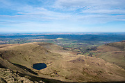 Landscape view from the summit of Pen Y Fan towards Llyn Cwm Llwch glacial lake and across the Brecon Beacons National Park, Wales, Powys, United Kingdom. Pen Y Fan is the highest point in the Brecon Beacons hill and mountain range in South Wales. The National Park was established in 1957 due to the spectacular landscape which is rich in natural beauty.  (photo by Andrew Aitchison / In pictures via Getty Images)