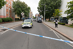 © Licensed to London News Pictures. 27/05/2019. London, UK.  Police at the crime scene in St Paul's Way, Mile End in Tower Hamlets, where a 23 year old man was stabbed multiple times yesterday, 26th May and died overnight in hospital.  Photo credit: Vickie Flores/LNP