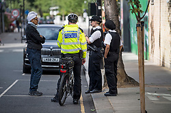 © Licensed to London News Pictures. 30/08/2020. London, UK. Police patrol the streets of Notting Hill, West London, on the day of the 2020 Notting Hill Carnival, which is being held virtually this year due to COVID-19 restrictions. Members of the public have been warned against congregating in the Notting Hill Area to celebrate the event. Photo credit: Ben Cawthra/LNP