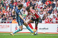 Middlesbrough forward Christian Stuani (18)  tackles Sunderland defender Patrick van Aanholt (3)  during the Premier League match between Sunderland and Middlesbrough at the Stadium Of Light, Sunderland, England on 21 August 2016. Photo by Simon Davies.