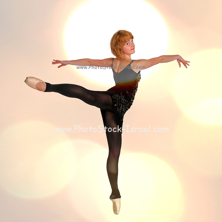 Female Ballet Dancer balances on her tows Digitally enhanced photograph