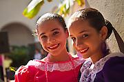 Traditional dancers in costume during the Festival of San Sebastian in San Juan, Puerto Rico.