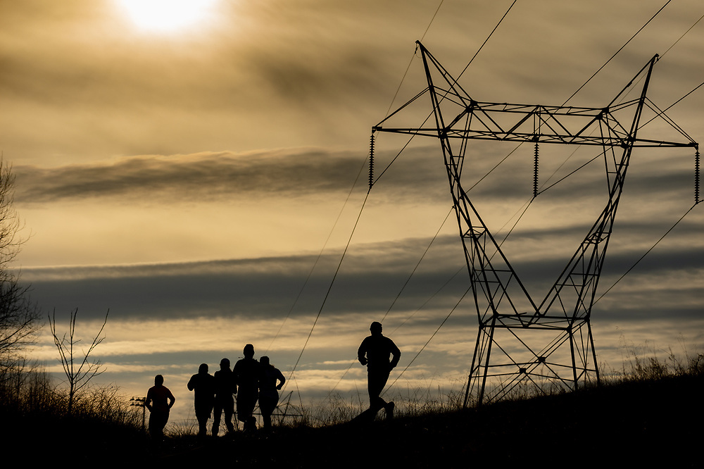 Running under the power lines at the Mid Maryland 50K Ultra.