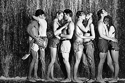 four couples embracing under a waterfall in New York City