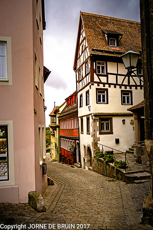 A small street lined with historic buildings in the old town of Rothenburg ab der Tauber in Germany