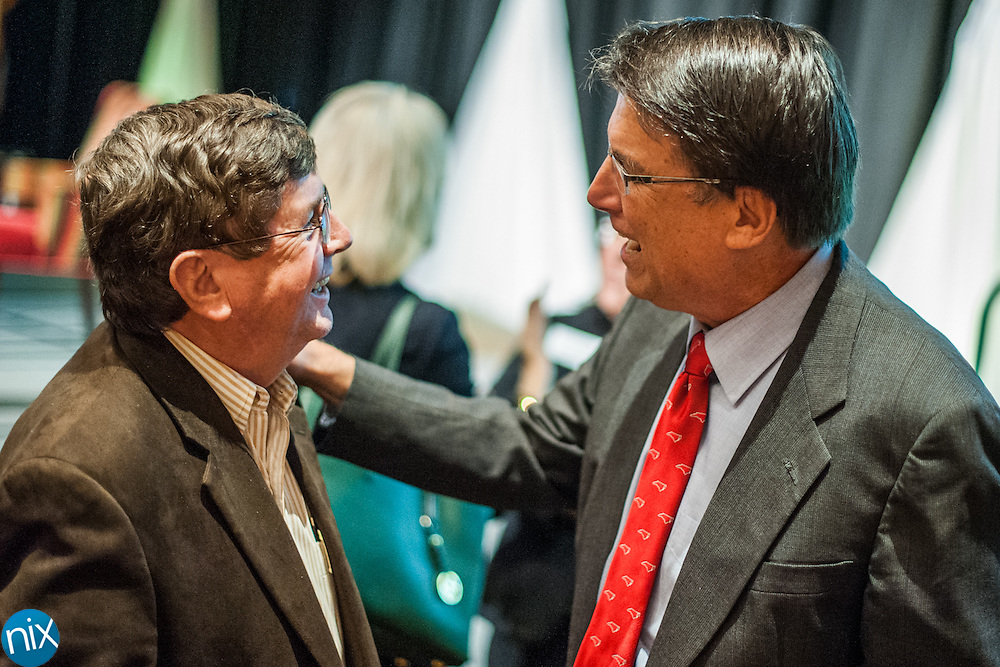 Governor Pat McCrory speaks with Kannapolis Mayor Darrell Hinnant during a State of the Region Summit hosted by the Cabarrus Regional Chamber of Commerce Thursday morning at Embassy Suites in Concord.