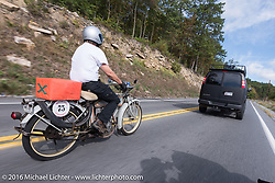 Dan Emerson of CT on his 1912 Excelsior gets help from a passerby during the Motorcycle Cannonball Race of the Century. Stage-2 from York, PA to Morgantown, WV. USA. Sunday September 11, 2016. Photography ©2016 Michael Lichter.
