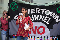 London, UK. 5th June, 2021. Ruth Fitzharris of Mums for Lungs addresses environmental activists and local residents protesting against the construction of the Silvertown Tunnel. Campaigners opposed to the controversial new £2bn road link across the River Thames from the Tidal Basin Roundabout in Silvertown to Greenwich Peninsula argue that it is incompatible with the UK's climate change commitments because it will attract more traffic and so also increased congestion and air pollution to the most polluted borough of London.