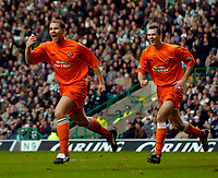Photo. Jed Wee, , Digitalsport<br /> Glasgow Celtic v Dundee United, Scottish Premier League, Celtic Park, Glasgow. 14/02/2004.<br /> Dundee United's Alan Archibald (L) celebrates after putting Dundee United into a shock lead.