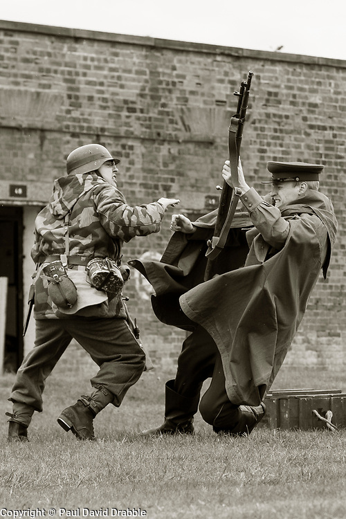 Panzer Grenadier and NKVD officer hand to hand combat during Battle renactment -  Nww2A Fort Paull<br /> <br />  Copyright Paul David Drabble<br /> 5th & 6th May 2019<br />  www.pauldaviddrabble.co.uk