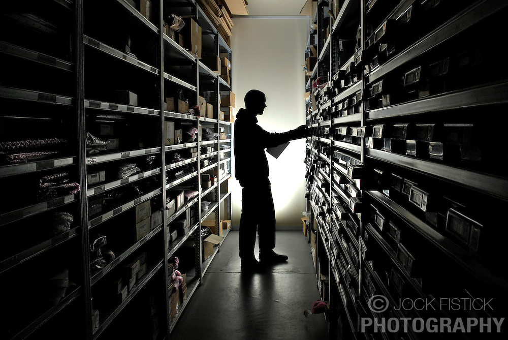 Photographed for Diebold Inc. Corporate Communications:<br /> <br /> An employee takes inventory at the Diebold Inc. warehouse facility in Zellik, Belgium.