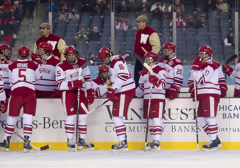 February 17, 2013:  Wisconsin head coach Mike Eaves behind the bench during NCAA Hockey game action between the Minnesota Golden Gophers and the Wisconsin Badgers at Soldier Field in Chicago, Illinois.  Wisconsin defeated Minnesota 3-2.