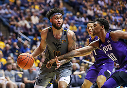Jan 14, 2020; Morgantown, West Virginia, USA; West Virginia Mountaineers guard Jermaine Haley (10) drives baseline against TCU Horned Frogs forward Diante Smith (10) during the second half at WVU Coliseum. Mandatory Credit: Ben Queen-USA TODAY Sports