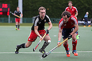Ben Francis of Wales (l) is challenged by Niels van Straaten of France (r).  Mens international hockey, Wales v France at the National Hockey Centre, Sophia Gardens in Cardiff, South Wales on Thursday 21st April 2016.<br /> pic by Andrew Orchard, Andrew Orchard sports photography.