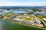 Nederland, Noord-Holland, Amsterdam, 27-09-2015; Zeeburg, Zeeburgeiland met zelfbouwkavels. Lokatie voormalige rioolwaterzuivering. Ring A10 en Zeeburgertunnel, Buiten-IJ en Nieuwe Diep.<br /> <br /> View of East of Amsterdam, and the former Eastern Docklands and the IJ.<br /> luchtfoto (toeslag op standard tarieven);<br /> aerial photo (additional fee required);<br /> copyright foto/photo Siebe Swart