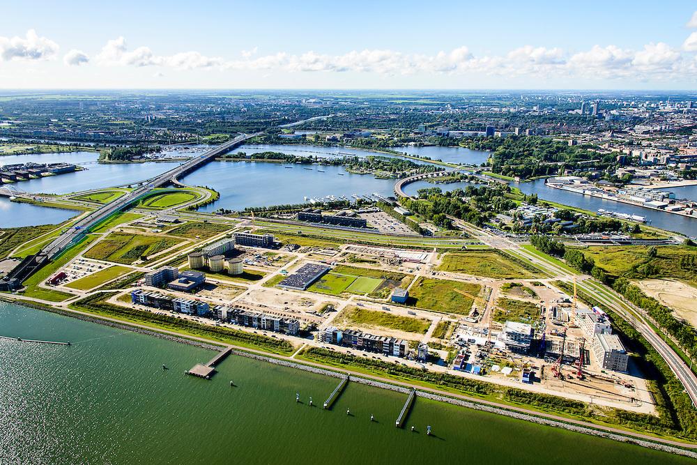 Nederland, Noord-Holland, Amsterdam, 27-09-2015; Zeeburg, Zeeburgeiland met zelfbouwkavels. Lokatie voormalige rioolwaterzuivering. Ring A10 en Zeeburgertunnel, Buiten-IJ en Nieuwe Diep.<br /> <br /> View of East of Amsterdam, and the former Eastern Docklands and the IJ.<br /> luchtfoto (toeslag op standard tarieven);<br /> aerial photo (additional fee required);<br /> copyright foto/photo Siebe Swart