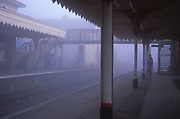 AYBR81 Foggy railway station early morning with bridge crosing to other platform