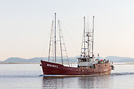 The Trawler Red Sky I (built 1962) is a fishing boat seen here returning to the dock at Steveston in Richmond, British Columbia, Canada.