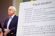 Aug 26, 2009 -- PHOENIX, AZ: Sen. JOHN McCAIN with his chart of the US' fiscal situation at North Phoenix Baptist Church in Phoenix, AZ, Wednesday. Sen McCain hosted his second town hall meeting on health care in two days Wednesday. About 1,000 people attended the meeting. Although most were opposed to President Obama's health care proposals and supported Sen McCain, there was a large group who support the President's health care efforts.  Photo by Jack Kurtz