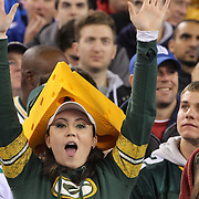 A Green Bay Packers fan wearing a cheesehead hat  during the New York Giants Vs Green Bay Packers, NFL American Football match at MetLife Stadium, East Rutherford, New Jersey, USA. 17th November 2013. Photo Tim Clayton