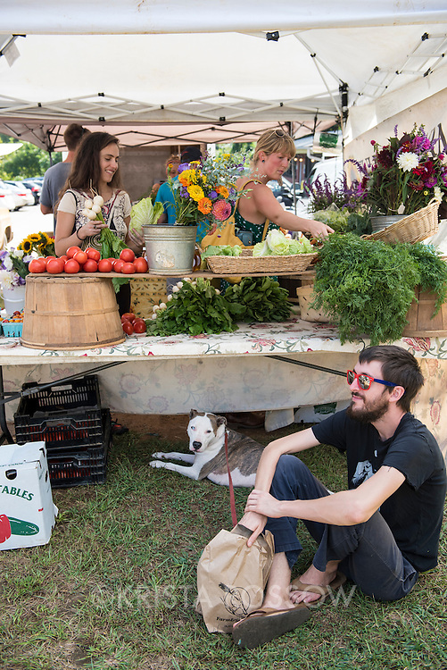Locals shop at a stand at the weekly River Arts District Farmers Market, which is held Wednesdays at 175 Clingman Avenue (next to All Souls Pizza) in the River Arts District of Asheville, North Carolina.
