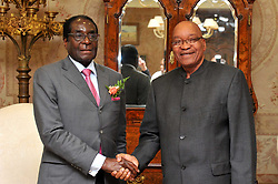 PRETORIA, June 10, 2011  Zimbabwean President Robert Mugabe (L) shakes hands with South African President Jacob Zuma in Pretoria, South Africa, June 10, 2011. Progress on a path to elections in Zimbabwe is expected to be discussed when Mugabe met his South African counterpart Jacob Zuma late on Friday, the Times newspaper in Johannesburg reported. (Credit Image: © Xinhua via ZUMA Wire)