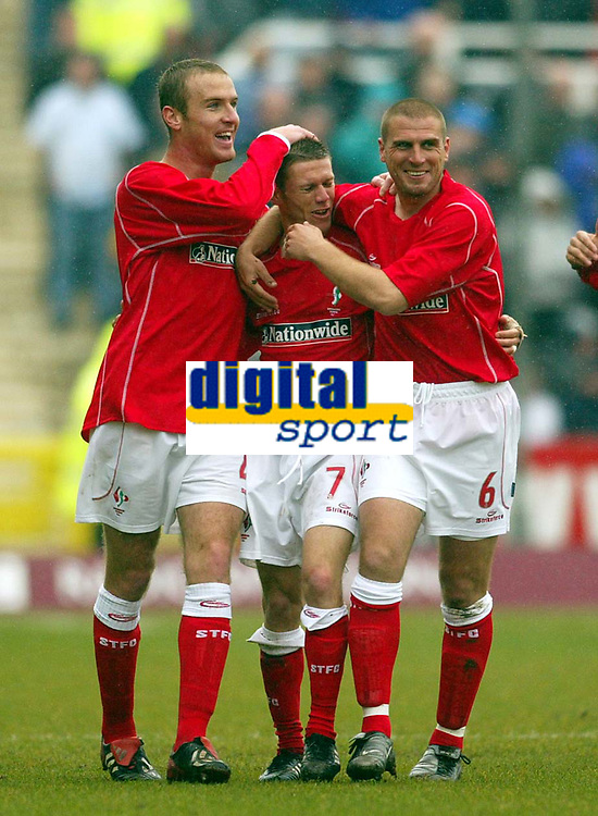 Photo: Scott Heavey.<br /> Digitalsport<br /> NORWAY ONLY<br /> Swindon Town v Hartlepool United. Nationwide Division Two. 08/05/2004.<br /> Goal-scorer, Sammy Igoe (Centre) celebrates with Sean O'Hanlon (L) and Andy Gurney