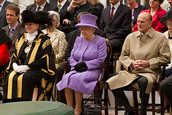 © Licensed to London News Pictures. 02/05/2012. Exeter, UK. Queen Elizabeth II, the Duke of Edinburgh and Cllr. Stella Brock, Lord Mayor of Exeter watch performance by Exeter College Students orchestra and choir. The visit to Princesshay shopping centre is the 2nd part of the Diamond Jubilee Tour to the South West. Photo credit : Ashley Hugo/LNP