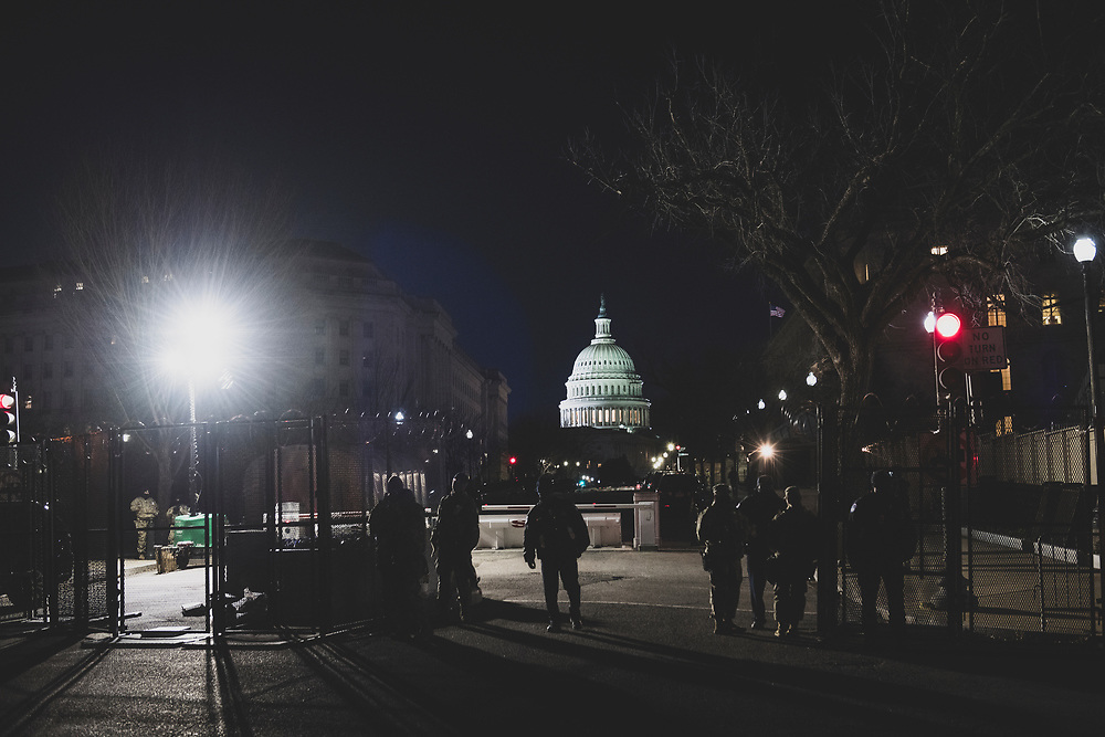 Washington DC, USA - January 19, 2021: Members of the Capitol Police and National Guard stand together to guard an entrance to Congressional office buildings and the Capitol Building.