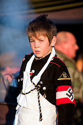 A young reenactor dressed as a member of the Nazi Hitler Youth<br /> 15th October 2011<br /> Image © Paul David Drabble