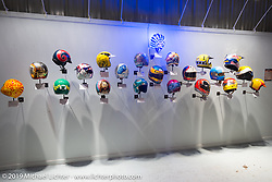 """21-Helmets"" from See See Motor Coffee in Portland with the help of Bell Helmets in the ""Built for Speed"" exhibition curated by Michael Lichter and Paul D'Orleans in the Russ Brown Events Center as part of the annual ""Motorcycles as Art"" series at the Sturgis Buffalo Chip during the Black Hills Motorcycle Rally. SD, USA. August 5, 2014.  Photography ©2014 Michael Lichter."