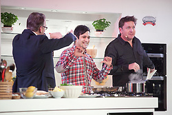© London News Pictures. 12/04/2012. Gravesend, Kent. L to R Lawrence Keogh, Jimmy Mistry and James Martin on stage at Glow Bluewater, Kent. Opening day of the BBC Good Food Show Spring at Glow, Bluewater, Kent.  Photo credit should read Manu Palomeque/LNP.