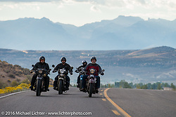 Dave Holzerland riding his 1935 Indian Four with other Cannonballers as they leave Springfield, Utah during Stage 13 (257 miles) of the Motorcycle Cannonball Cross-Country Endurance Run, which on this day ran from Elko, NV to Meridian, Idaho, USA. Thursday, September 18, 2014.  Photography ©2014 Michael Lichter.