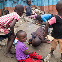 Children in Mathare by Millicent Lodenyi