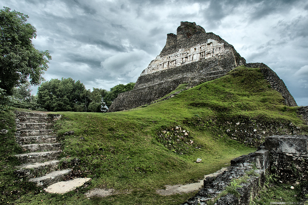 "Xunantunich, is a Maya term meaning ""stone woman"". The largest structure is El Castillo which rises 130 feet from the Plaza floor, and is covered in elaborately carved friezes. Xunantunich, Belize."