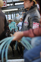 Team ropers wait their turn to compete on Thursday, opening night for the 2013 California Rodeo Salinas.