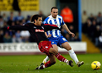Photo: Olly Greenwood.<br />Colchester United v Stoke City. Coca Cola Championship. 16/12/2006. Stoke's Clint Hill goes for the ball with Kevin Watson