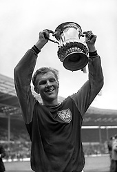 West Ham United captain Bobby Moore celebrates with the FA Cup after his team's 3-2 victory