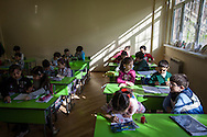 Second grade Syrian-Armenian children study at the Cilician school in Yerevan, Armenia's capital city. The children follow Syrian curriculum in Arabic from books brought from Syria and photocopied for students. Although the vast majority of Syrian Armenian children understand Armenian fluently, the school teaches the Syrian curriculum so that the qualifications will be recognised in Syria, where the children hope to return.