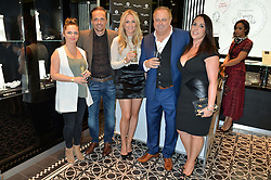 Left to right, HAYLEY ETHERINGTON, her brother footballer MATTHEW ETHERINGTON, his wife STEPHANIE ETHERINGTON, PETER ETHERINGTON and his wife SOPHIE ETHERINGTON at the Thomas sabo & Professional Player cocktail reception at Thomas sabo, 65 South Molton Street, London on 30th September 2015.