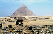 Ancient Egypt: Great Pyramid of Cheops, Giza,  one of the seven wonders of the ancient world overlooking Muslim cemetery.